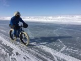 Cycling the ice road, keeping to where there is some snow for grip