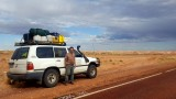 Bob with his vehicle, near Coober Pedy
