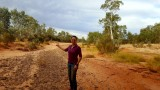Celebrating reaching the Stuart Highway crossing of the Finke River